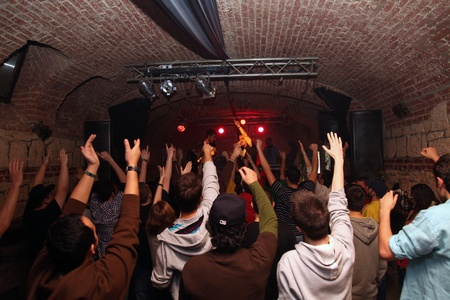 young people at a concert in romania applauding Editorial