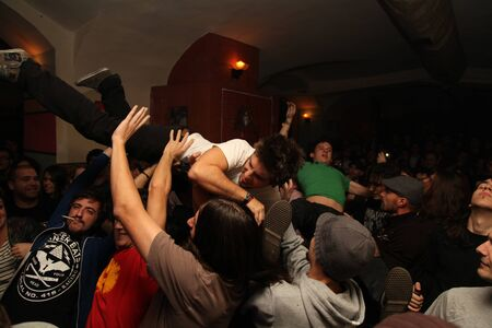 stage dive at indoor concert in romania