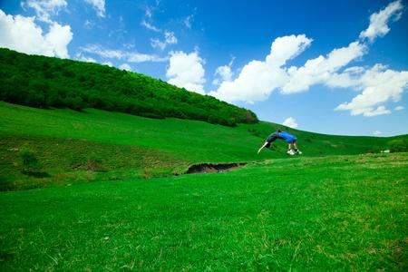 BACKFLIP: backflip in nature Stock Photo