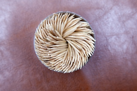 toothpicks in a jar isolated on leather background Stock Photo