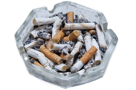 ashtray with cigarette butts isolated on a white background photo