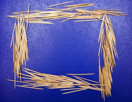 frame made out of toothpicks on a blue background