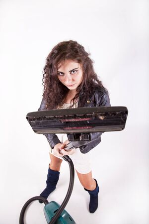young brunette girl holding a vacuum birds eye view
