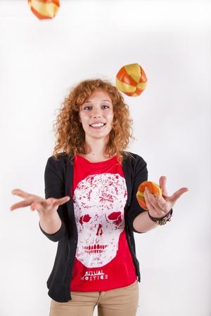 redhead beautifull young woman juggling with circus balls Stock Photo - 15273932
