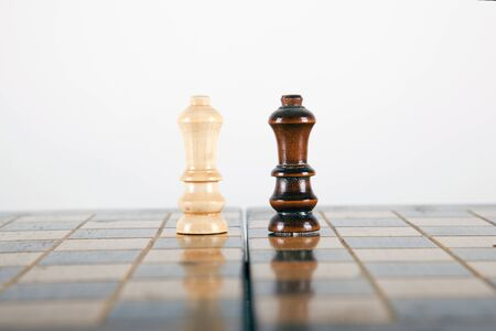 chess pieces going head to head with two kings