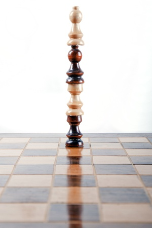 tower made out of several chess pieces stacked on top of each other photo