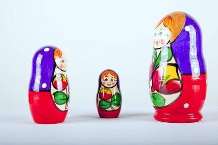 made russia: matryoshka dalls on a white background smilling Stock Photo