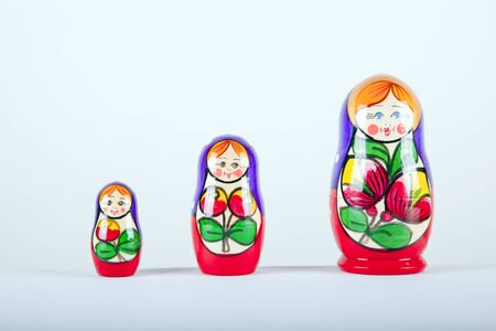 matryoshka dalls in a line on a white background smilling Stock Photo