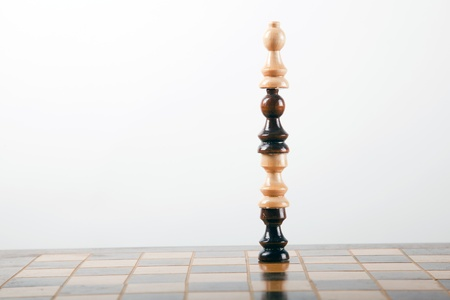 tower made out of several chess pieces stacked on top of each other Stock Photo