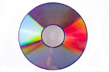 Used damaged and scratched CD on a white background
