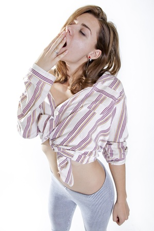 young attractive woman yawning in pijamas after wacking up photo