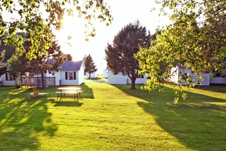 holiday house on green lawn with bright sun Stock Photo - 17365411