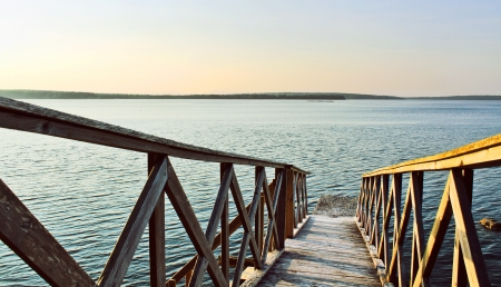 Ocean wood bridge elading to the water at sunset Stock Photo - 17365394