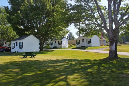 small camping houses on green lawn in summer