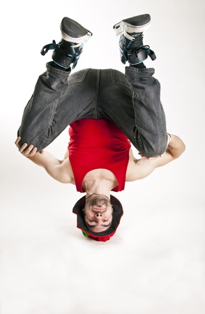 young man dancer bboy standing on his head in balance Stock Photo