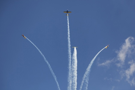nesterov: airplanes on clear sky breacking formation with smoke trail Editorial