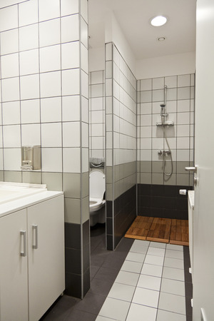 shower cubicle: big bathroom with shower tiles and white walls