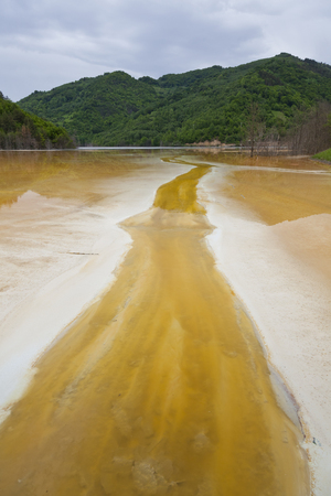 inundated: Poluted lake in the mountains from a mine in romania