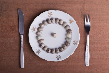 house sparrow eggs on a plate with fork and knife
