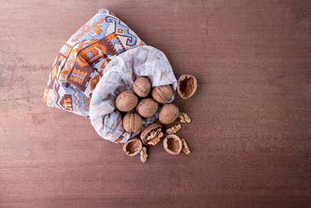 walnuts in a back on wood background with side light