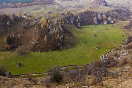 romanian landscape at autumn with river and mountains Stock Photo