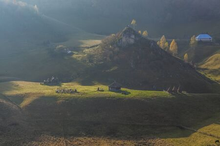 morning light on romanian landscape with hills and traditional houses Stock Photo