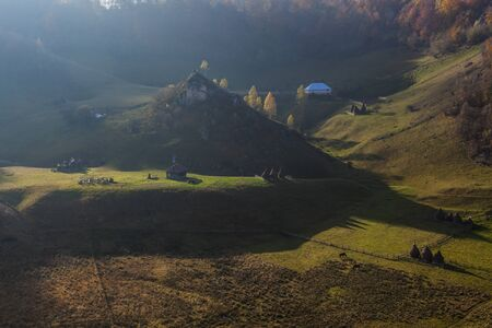romanian mountain village at first light in autmumn Stock Photo