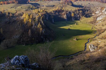 romanian landscape with hills and rivers at sunrise Stock Photo