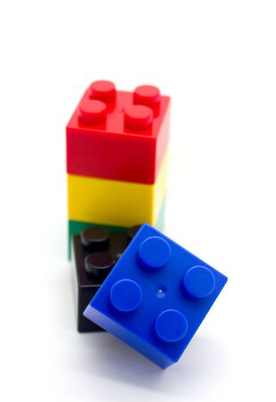 Plastic building blocks on white background Stock Photo