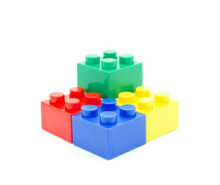 Plastic building blocks on white background photo
