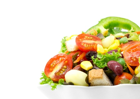 Fresh vegetable salad isolated on white photo