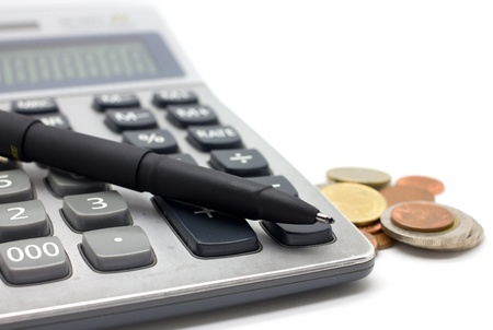 Coins and calculator  on white background Stock Photo
