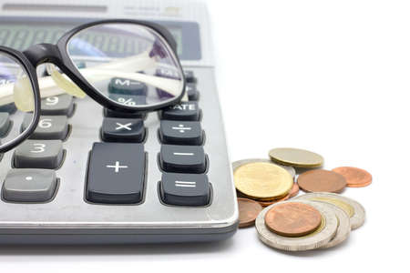 Coins and calculator  on white background photo