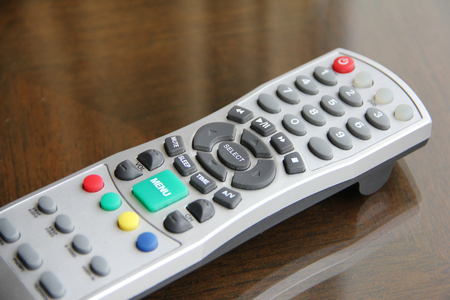 tv remote control on the table photo