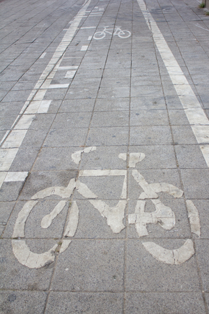 bicycle road sign on the floor photo