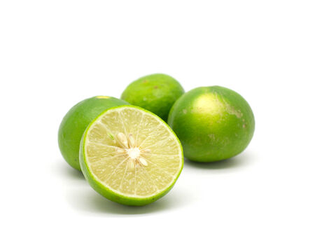 Green lemon fruit on isolated white  photo