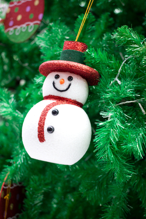 Christmas decorations with snowman on tree. photo