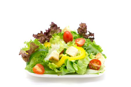 Fresh vegetable salad isolated on white. photo
