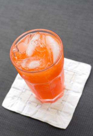 refreshing fruit punch beverage in glass. photo