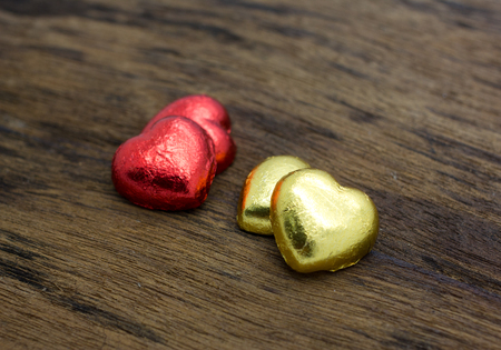 chocolate hearts on a wooden table - valentines composition photo