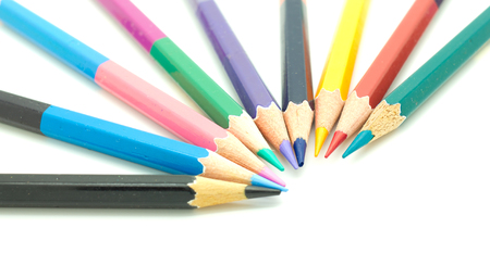 A row of colorful pencils on a white surface photo