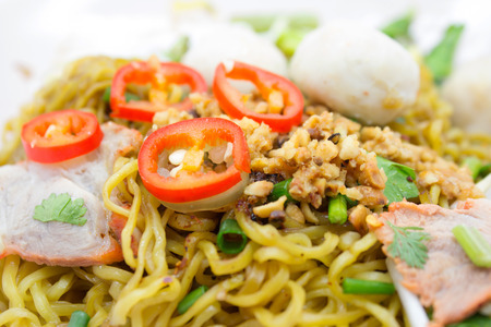 Asian style noodle with pork, meat ball and vegetables photo