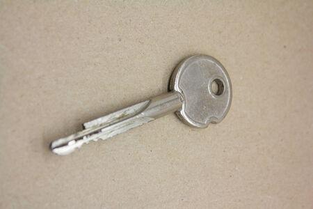 door keys on brown background photo