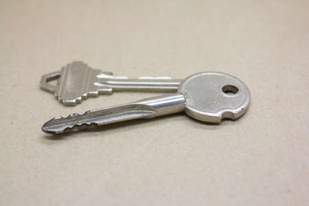 door keys on brown background photo
