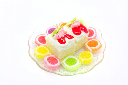 cake and sweet jelly on white background photo