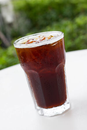Delicious ice coffee americano on wood table. photo