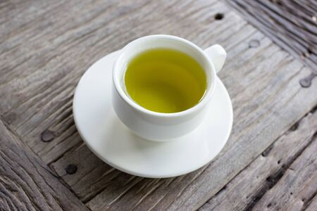for tea: a cup of green tea on wood board, drink for health