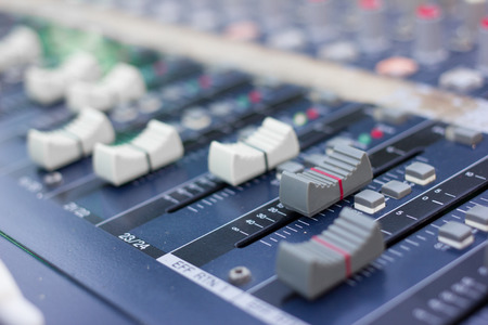 fader: Part of an audio sound mixer with buttons and sliders .  Stock Photo