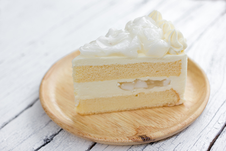 layer cake: a piece of coconut cake on dish.
