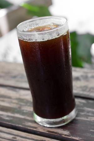americano: Delicious ice coffee americano on wood table.